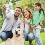 Family-In-Park-Taking-Selfie