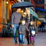 Family-Protected-From-Rain-While-Walking